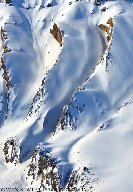 Serpentine red mountains, snow watermark